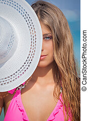 woman on vacation with sunhat