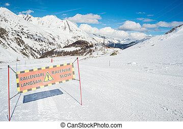 Slow skiing warning sign