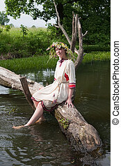 Pretty girl in flower chaplet at river - girl in russian...