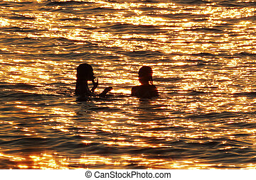Swimmers in Lake Huron at Sunset