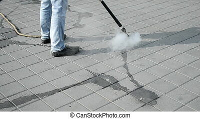 cleaning with hot steam, street - cleaning of the street...
