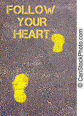 Yellow footsteps on sidewalk towards Follow your heart...
