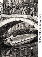 Boat under a Bridge in Venice. Black and White