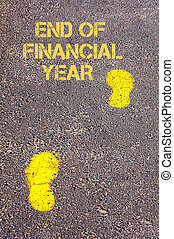 Yellow footsteps on sidewalk towards End of Financial Year...