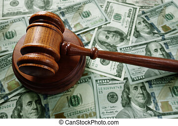 Judge gavel on cash - Judges legal gavel on assorted cash...