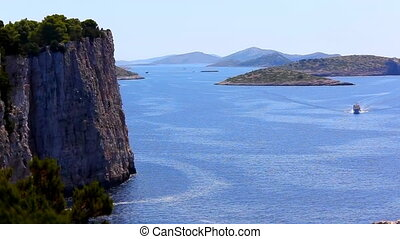 Ferry passing Dugi Otok coastline - Ferry passing by big...