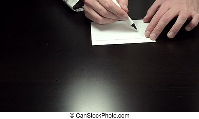 Hands writing the notice ASAP - Man's hands draw the word...