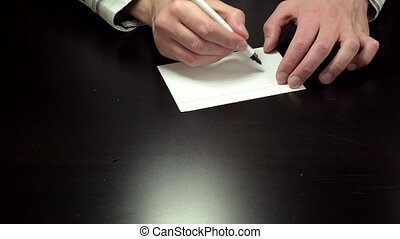Hands writing the notice contract - Man%u2019s hands draw...