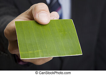 Green Business Card - Man giving out a green business card