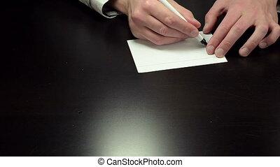 Hands writing the notice top secret - Man%u2019s hands draw...