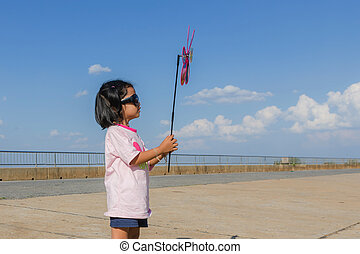 Asian girl with wind turbine in hands