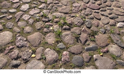 walking on old cobble-stone road. Cobble-stone road...