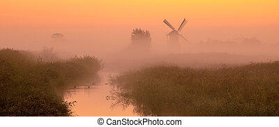 Dutch landscape with historic windmill - Typical dutch...