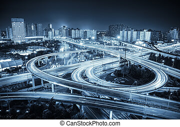 city road junction at night ,interchange highway with blue...