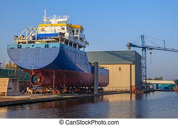 Ship Construction Wharf - Construction of a Cargo Ship on a...