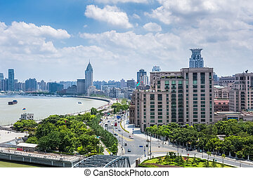 shanghai bund in daytime - beautiful shanghai bund against a...