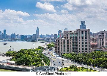 shanghai bund in daytime - beautiful shanghai bund against a...
