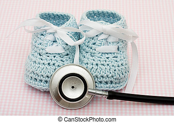 Healthcare Costs - A pair of blue baby booties and a...