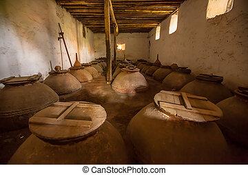Olive oil cellar - Dark brown old historic Olive oil storage...