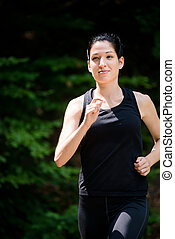 Jogging in nature - Running for health - young woman jogging...