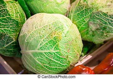 Heads of cabbage on a counter in the market
