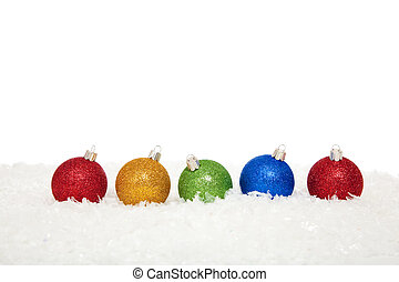 assorted colored christmas ornaments in snow - Assorted...