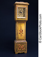 retro alarm clock tower shaped on black background - golden...