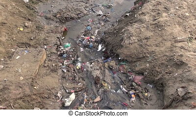 open sewerage near Ganges river - polluted dirty open...