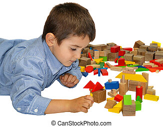 Cute little boy playing with wooden blocks