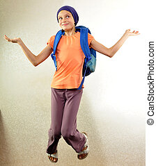 schoolboy with backpack jumping and running - Portrait of a...