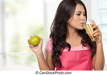 happy young woman with apple juice - portrait of happy young...