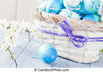 Spring basket Easter eggs blue tone