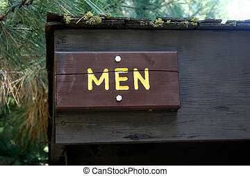 Men sign - A wooden sign hung over the entrance to a mens...