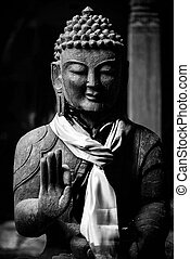 Buddha statue in black and white - Wooden Buddha statue in...