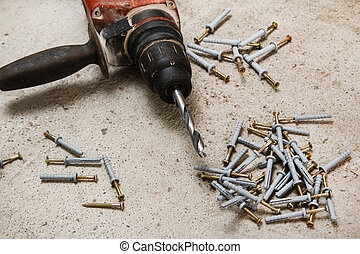 Drilling machine and dowels