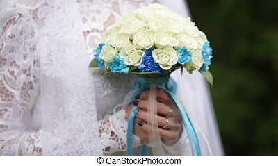 Bridal bouquet - Young Bride is holding bouquet