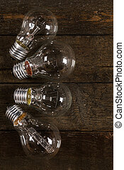 Glowing lightbulbs on wooden background