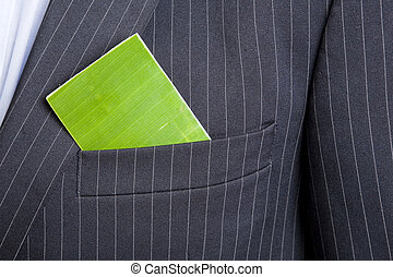 Green Business Card - Man with a green business card in his...