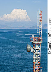 Red and White Microwave Tower over Blue Sea