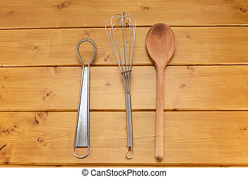 Sauce and balloon whisks and wooden spoon