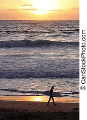 Surfer with surf board on beach - Silhouette of a surfer...