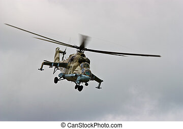 Helicopter gunship in flight - Helicopter gunship conducting...