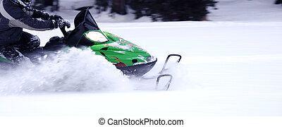 Snowmobile turn - Snowmobile in fresh powder making a...