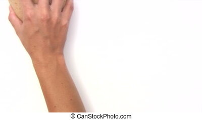 Cleaning the Whiteboard - Female hand erasing whiteboard...