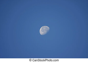 moon in morning - beautiful half moon on blue sky in morning...