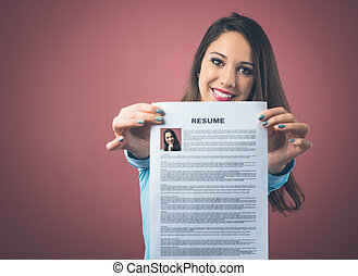 Young woman holding her resume - Young smiling woman holding...