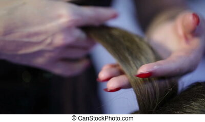 Combing hair - Hairdresser using comb hair hair divides