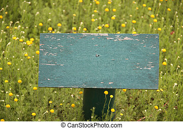 wooden sign post - old green paint wooden sign post in...