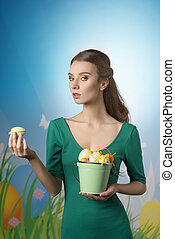 Ester time - Easter woman in green dress with long hair and...