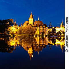 Vajdahunyad Castle  is reflected in water, Budapest